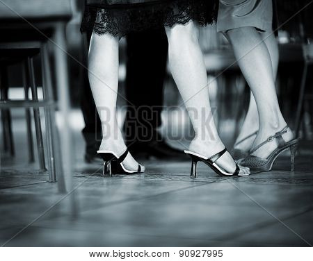 Feet Of Female Wedding Guests In Heel Shoes In Party