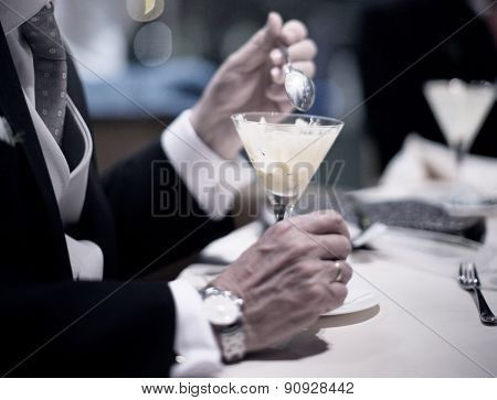 Man In Wedding Banquet Party Eating Dessert