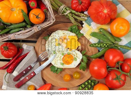 eggs with vegetables on wooden table