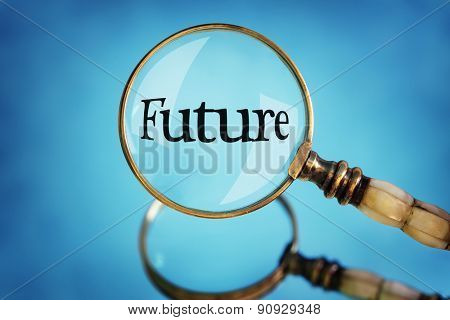 Magnifying glass focus on the word future concept for planning, vision and  looking forward
