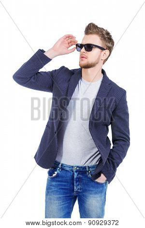 Portrait of confident young man wearing jeans and jacket. Men's beauty, fashion. Isolated over white.