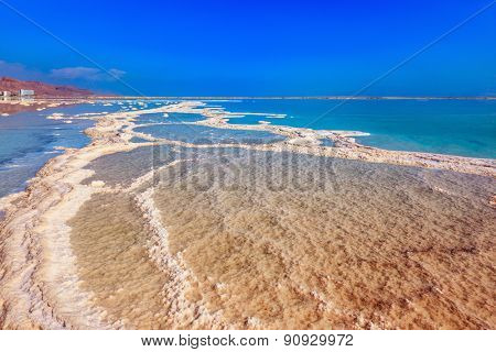 Dead Sea off the coast of Israel. Vaporized salt form whimsical patterns on the water surface