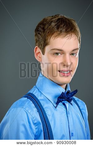 Portrait of a romantic young man looking at camera. Men's beauty, fashion.