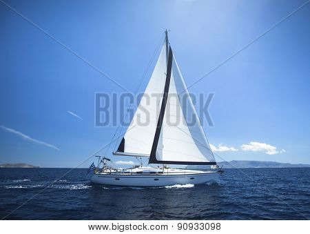 Sailing Yacht from sail regatta race on blue water Sea.