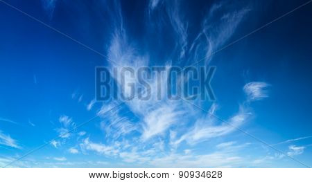 Blue sky with white cirrus clouds