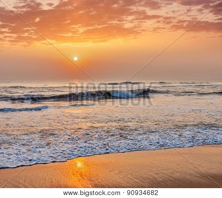 Serene tranquil morning seascape on sunrise on beach