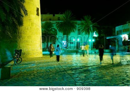 People Walking In Arabian Medina By Night