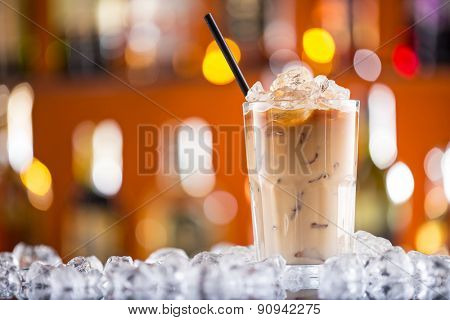 Ice coffee on bar desk, close-up.