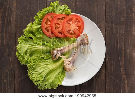 Bone Chicken And Vegetable On Wooden Background.