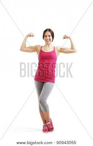 full length portrait of smiley woman showing her biceps and looking at camera. isolated on white background