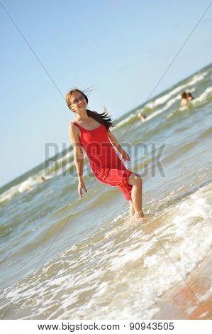 Young Pretty Woman Having Fun At The Beach
