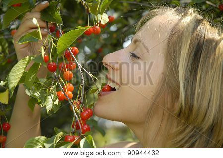 Nice Girl In The Garden With Cherry