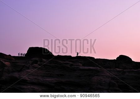 Photographer silhouette sunset at rock holes Stone View Sam Phan Bok Grand Canyon in thailand