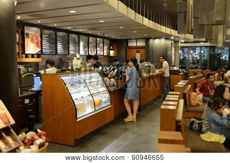 SHENZHEN, CHINA - MAY 17, 2015: Starbucks cafe interior. Starbucks Corporation is an American global coffee company and coffeehouse chain based in Seattle, Washington