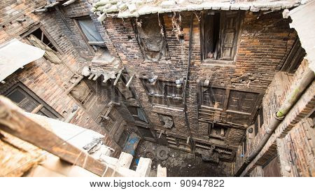 BHAKTAPUR, NEPAL - CIRCA DEC, 2013: Nepali house in the city center. The caste system is still intact today but the rules are not as rigid as they were in the past.