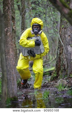 Running technician in professional uniform with silver suitcase in contaminated floods area