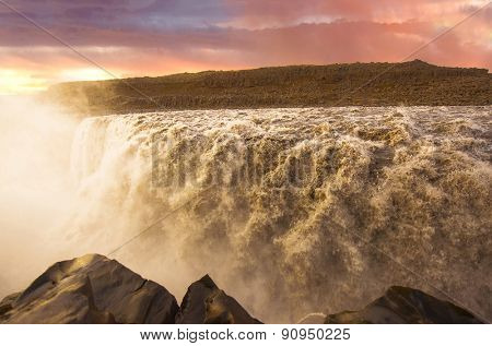 Sunset over, Dettifoss the most powerful waterfall on Iceland and in the whole Europe. It is located in Jokulsargljufur National Park the northeasten Iceland
