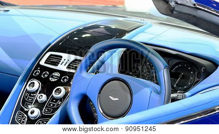 Close Up Steering Wheel Of Blue Aston Martin Series Vanquish