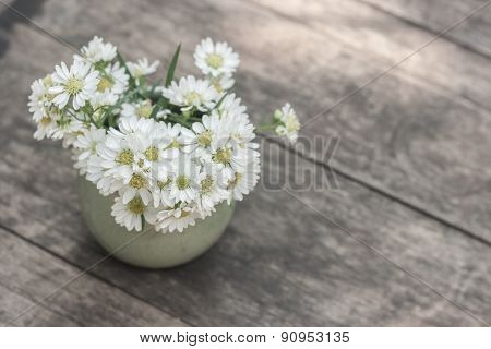 Blossom Flower In Vase On Table.
