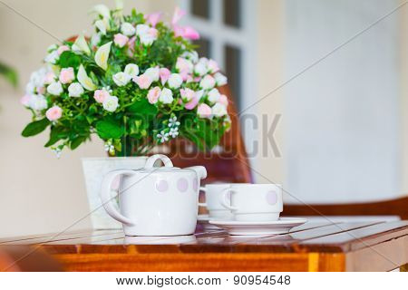 White Porcelain Set For Tea Or Coffee On Wooden Table At Home Exterior