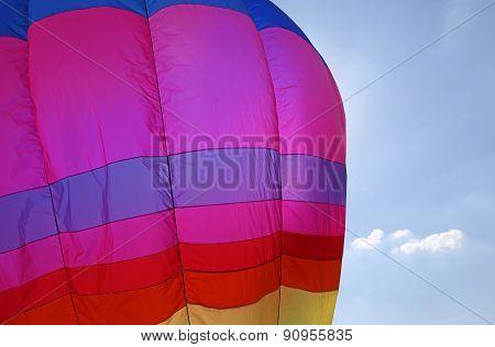 Colorful Hot Air Balloon Flies In Blue