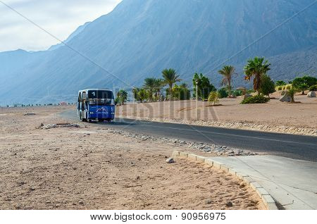 Local Minibus On The Road In The Resort Area Of Egypt
