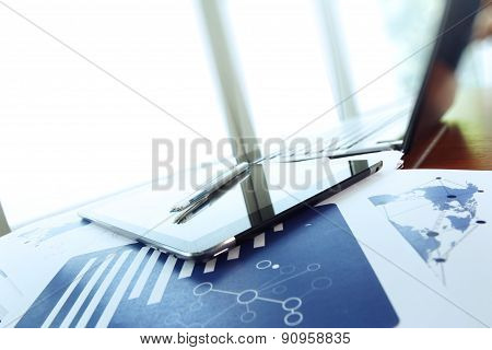 Business Documents On Office Table With Smart Phone And Digital Tablet As Work Space Business Concep