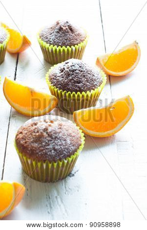 Orange Muffins At The  Table