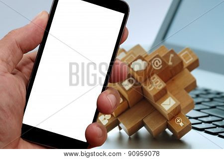 Closeup Of Hand Touching Blank Screen Of Smart Phone With Blurred Background As Concept