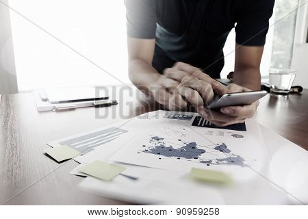 Moving Image Of Business Creative Designer Working With Smart Phone And Tablet Computer At Office As