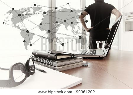 Young Creative Designer Man Working At Office And Social Network Media Diagram As Concept