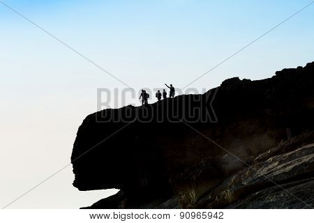 Tourist Group On The Top Of The Cliff, Photographing And Enjoying In The View. Exploring The Country