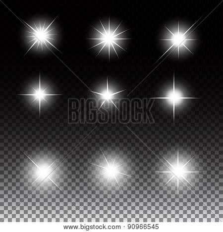 Set of Glowing Light Stars with Sparkles Vector Illustration