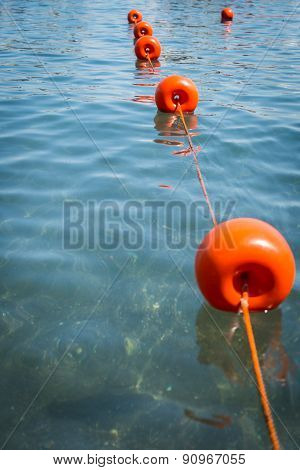 Mediterranean seaport yacht. berth boats fenced red buoys.