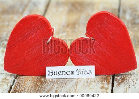 Buenos Dias (Good morning in Spanish) with two red wooden hearts