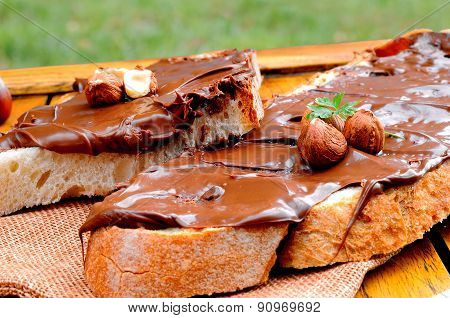 Bread With Chocolate Cream And Hazelnuts Outdoor Closeup