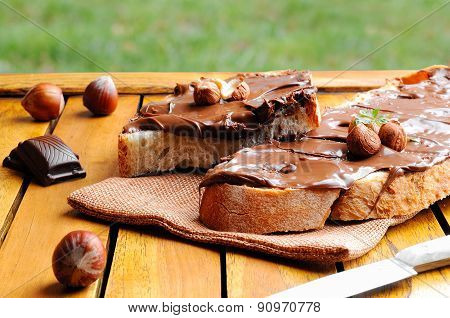 Bread With Chocolate Cream And Hazelnuts Outdoor