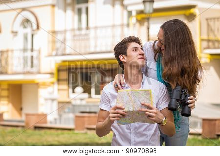 Girl and guy on the streets of European cities. Couple walking along the picturesque street