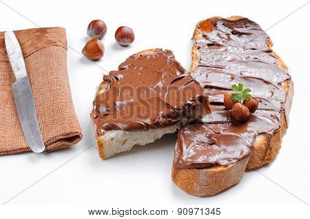 Bread With Chocolate Cream And Hazelnuts White Isolated