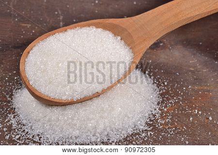 White Sugar In A Spoon
