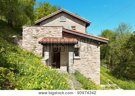 country house in the woods, stone walls, external