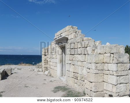 Ancient Chersonese, wall of Basilica 1935 (VI-X c.) against Black sea and blue sky, Sevastopol, Crim