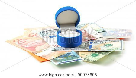 Ring in box and money, isolated on white