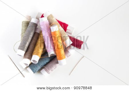 Colored Sewing Threads On A White Table