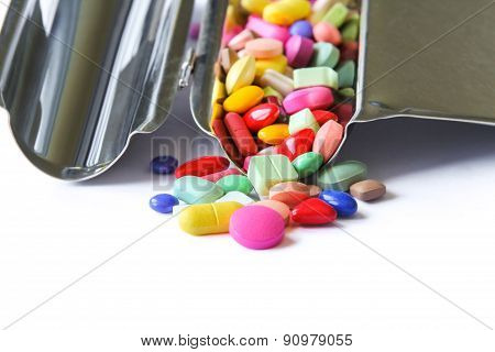 Close up of medical pills on stainless steel counting tray.