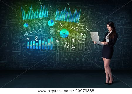 Businesswoman in office with lapotp in hand and high tech graph charts concept on background