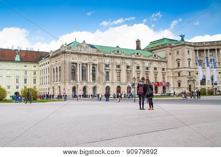 Hofburg palace and tourists near it in Vienna