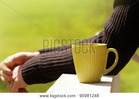 man drinking tea outdoors