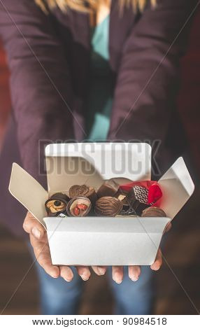 Hands Holding A Box Of Chocolates