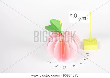 paper apple with vitamin and card with word